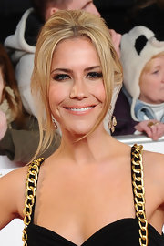 Heidi Range attended the National Television Awards wearing her hair in an updo featuring volume through the crown and long face-framing strands.