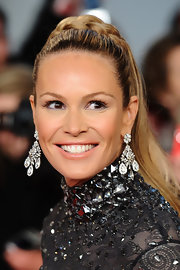 Elle MacPherson wore a pale glossy nude lipstick at the National Television Awards.