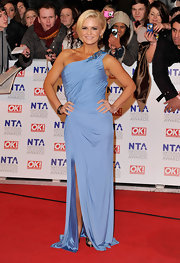 Kerry dons a sky blue one-shoulder evening dress with a high slit for the National Television Awards.
