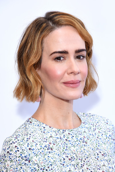 Sarah Paulson attended the Women Making History Awards wearing a short wavy hairstyle.