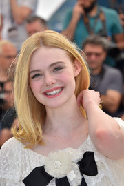 Elle Fanning topped off her look with a cute flippy 'do when she attended the Cannes photocall for 'The Neon Demon.'