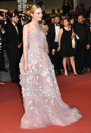 Elle Fanning looked downright darling in a flower-adorned strapless gown by Zuhair Murad at the Cannes screening of 'The Neon Demon.'