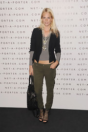 Poppy paired her army green cargo pants with a black blazer and black strappy sandals.