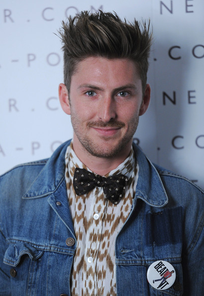 Henny Holland paired his bow tie with a spiked haircut.