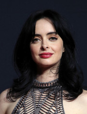 Krysten Ritter sported bouncy waves with parted bangs at the Netflix FYSEE kickoff event.