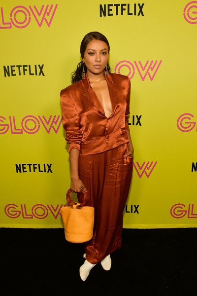 Kat Graham donned a rust-colored satin pantsuit for the 'Glow' roller-skating event.