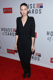 ROoney looked bold and stylish in this sharp black jumpsuit at the 'House of Cards' New York premiere.