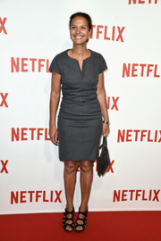 Isabelle Giordano kept it low-key with this gray sheath dress at the Netflix launch party in Paris.