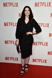 For a dressier finish, Laura Prepon paired her blouse with an embellished black pencil skirt.