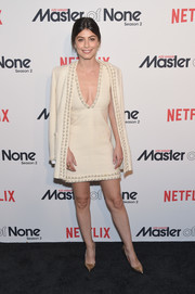 Alessandra Mastronardi cut a chic figure in a white tweed skirt suit by Chanel at the premiere of 'Master of None' season 2.