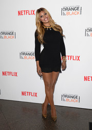 Laverne Cox flaunted her pins in a super-short Opening Ceremony sweater dress during the 'Orange is the New Black' panel discussion.