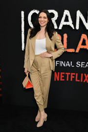 Laura Prepon finished off her look with a triangular leather purse by Mlouye.