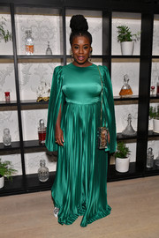 Uzo Aduba was glowing in a caped, wide-leg emerald jumpsuit by SemSem at the premiere of 'Orange is the New Black' season 7.