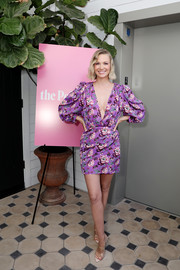 January Jones styled her frock with on-trend PVC mules.