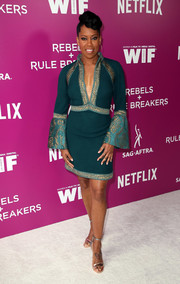 Regina King teamed her dress with a pair of metallic sandals.