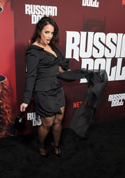Dascha Polanco complemented her dress with a pair of black T-strap pumps by Christian Louboutin.