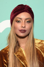 Kat Graham topped off her dramatic look with a wine-red velvet turban.