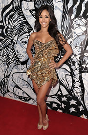 Melanie was a golden girl at the Maxim Hot 100 Party in a bead encrusted structural strapless cocktail dress.