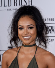Karrueche Tran pulled her hair back into a messy ponytail for the New Era Style Lounge event.