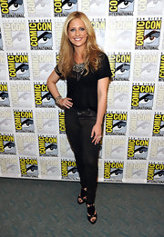 Buffy's back! Sarah Michelle Gellar appeared at Comic-Con in sexy leather pants teamed with Dior's studded black leather Extreme Gladiator heels.