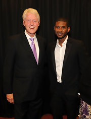 Bill Clinton mixed things up by wearing a metallic lavender tie with his black business suit.