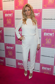 Chantelle Houghton went for the monochromatic look with a white top and matching white slacks.