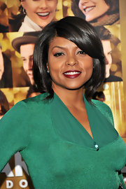 Taraji P. Henson paired a rich Merlot lipstick with her vivid green blouse at the NYC premiere of 'New Year's Eve.'