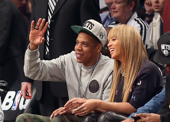 Beyonce went for a more sleek and straight 'do with a blunt bang and flat ironed coif.
