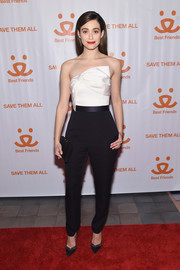 Emmy Rossum looked sweet and trendy on the red carpet in a bow-adorned black-and-white jumpsuit while attending the Best Friends Animal Society Benefit.
