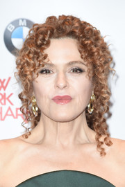 Bernadette Peters wore her signature tight curls gathered into a ponytail during the New York Philharmonic's opening gala.