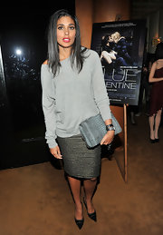Rachel Roy matched her slouchy gray sweater to a gray snakeskin clutch.