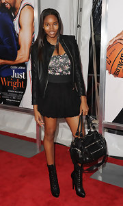 "Model Damaris Lewis showed off her zipper-clad shoulder bag while attending the premiere of ""Just Wright""."