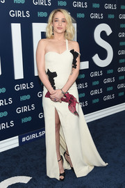 Jemima Kirke got all prettied up in an ivory Rosie Assoulin one-shoulder gown with a high slit and black flower appliques for the New York premiere of the final season of 'Girls.'