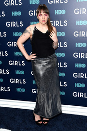 Lena Dunham looked disco-ready in a black and silver halter gown by Todd Oldham at the New York premiere of the final season of 'Girls.'