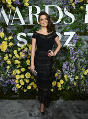 Hayley Atwell teamed her dress with a studded silver clutch by Tod's.