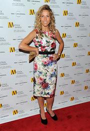 Sheryl Crow was all smiles at the Matrix Awards in her pretty floral print dress. This look is on trend for the spring season ans Sheryl wore is well.