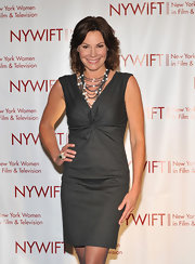LuAnn dressed up her understated gray dress with a multi-strand pearl necklace.