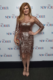 Connie Britton complemented her sparkly dress with strappy gold heels.