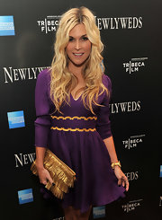 Tinsley Mortimer matched the fanciful gold trim of her purple mini dress with a fun fringed clutch.