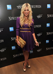 Tinsley Mortimer wore a purple cocktail dress with gold detailing at the 'Newlyweds' New York premiere.
