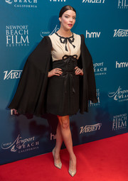 Anya Taylor-Joy looked dramatic in a caped black-and-white cocktail dress by Gucci at the Newport Beach Film Festival.