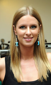 Nicky Hilton added a twist to the classic smoky eye at Fashion's Night Out in New York. Instead of a standard black eye pencil and gray shadow, she went for shades of green and teal.