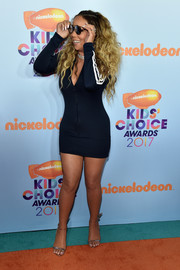 Mariah Carey paraded her curves in a deep-V navy mini dress by Adidas at the 2017 Kids' Choice Awards.