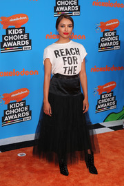 Kat Graham dressed up her tee with a black tulle maxi skirt, also by Cinq a Sept.