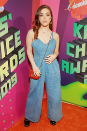 Baby Ariel styled her look with a red chain-strap bag by Gucci.