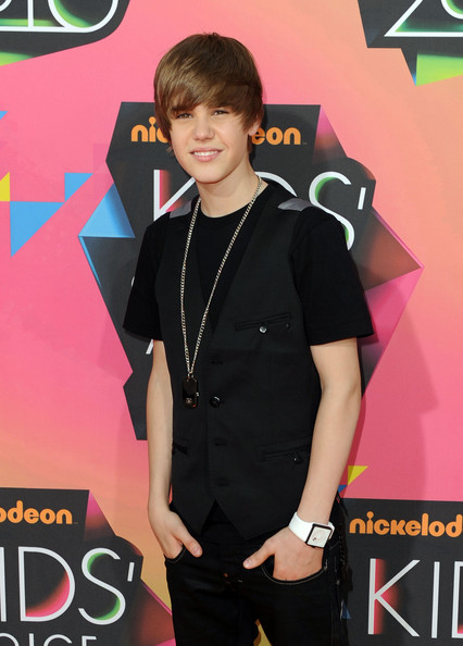 Justin wore a white square-faced watch.