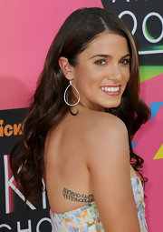 Nikki completed her look with simple hoop earrings.
