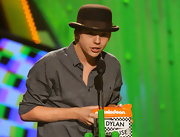 """Dylan Sprouse donned a quirky chocolate bowler hat while collecting his """"Nickelodeon Kids' Choice Award."""""""