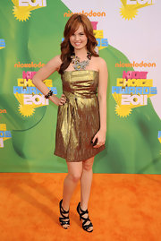 Debby shimmered in a gold strapless dress and a dramatic statement necklace at the Kids' Choice Awards.