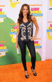 Sofia Vergara added sparkle to her Kids' Choice Awards look with a silver glittery clutch.